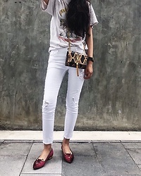 Cinder Chayanan - Saint Laurent Crossbody Tasselled Leather Bag (Python), Charlotte Olympia Mid Century Kitty (Velvet), Topshop Ripped White Jeans - Lazy