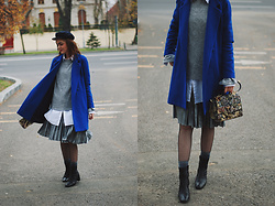 Andreea Birsan - Cap, Cobalt Blue Coat, Grey Bell Sleeve Sweater, Embroidered Bag, Silver Metallic Pleated Midi Skirt, Fishnet Tights, White Button Down Shirt, Glitter Socks, Leather Ankle Boots - Where to find the perfect blue coat
