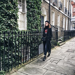 Andreea Birsan - Marina Cap, Black Maxi Coat, Vintage Wash Mom Jeans, Black Turtleneck Sweater, Graphic Tshirt, Ankle Boots, Quilted Leather Crossbody Bag - The maxi coat