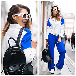 Luana Codreanu - Chathias Edeline Backpack, Ppq Leather Jacket, Answear Jumpsuit, Adidas Sneakers, Jeremy Scott Sunglasses - The ROYAL blue