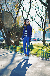 Andreea Birsan - Newsboy Cap, Scarf, Stripe Top, Blue Real Suede Bomber Jacket, Reworked Step Hem Jeans, Stan Smith White Sneakers, Green Suede Crossbody Bag - Step hem jeans AKA the most popular denim trend of the year