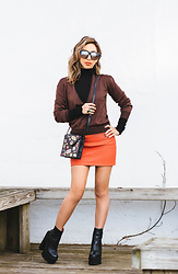 Eliza Romero - Quay Australia On The Prowl Sunglasses, River Island Gold Hoop Earrings, Free People Black Turtleneck, Free People Gold Dust Pullover, Monki Badge Print Crossbody Bag, Asos Red Leather Miniskirt, Jeffrey Campbell Shoes Black Platform Boots - Hugging The Block