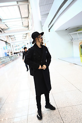 INWON LEE - Byther Urban Black Fedora, Byther Black Wool Lapel Coat, Byther Songchi Backpack - At the Airport
