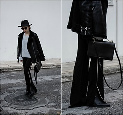 Theoni Argyropoulou - Zara Ankle Boots, Wide Leg Pants, Zara Shoulder Bag, Missguided Aviator Jacket, Chunky Knit, H&M Round Necklace, H&M Wool Hat - Side striped pants on somethingvogue.com