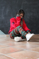 Karen Cardiel - Red Flurry Bomber Jacket, Leggings, Nike White Sneakers - InspiRED