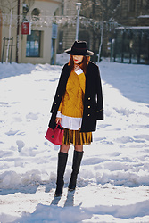 Andreea Birsan - Double Breasted Military Coat, Yellow Turtleneck Sweater, White Button Down Shirt, Knee High Boots, Fishnet Tights, Pink Mini Tote Bag, Black Fedora Hat - How to wear knee high boots with midi skirts II