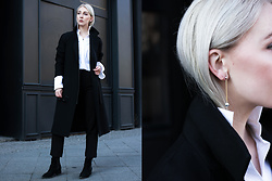 Leonie // www.noanoir.com - Cos Black Long Coat, H&M White Button Up Shirt With Oversized Sleeves, Kiomi High Waisted Black Cropped Trousers, Aeyde Black Suede Leather Ankle Pointy Boots, Maria Black Silver And Gold Minimal Statement Earring - Sleeves