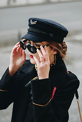 Andreea Birsan - Grace Ring, Olive Leaf Ring, Military Hat, Retro Sunglasses, Double Breasted Black Military Coat, Hoop Earrings, Red Crossbody Bag, Neck Scarf - A touch of gold