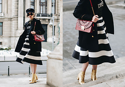 Andreea Birsan - Striped Midi Skirt, Military Cap, Graphic T Shirt, Red Shoulder Bag, Gold Metallic Ankle Boots, Retro Sunglasses, Double Breasted Military Coat, French Knotted Scarf - Valentine's Day outfit idea with a twist