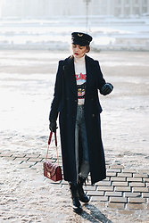 Andreea Birsan - Military Coat, Red Shoulder Bag, Navy Maxi Coat, Two Tone Mom Jeans, Leather Cut Out Biker Boots, Graphic Tee, White Turtleneck Sweater - How to pull off the military trend