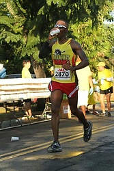 Thomas G - Hoka One Bondi 2, Brooks Running Shorts, Marathon Maniacs, Good Luck Beads, Jal Honolulu Marathon - Drinking on the go : )
