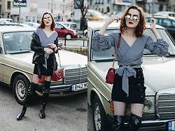 Andreea Birsan - Gingham Wrap Top, Black Lace Up Mini Skirt, Patent Over The Knee Boots, Red Shoulder Bag On Sale, Round Mirrored Sunglasses, Leather Jacket - The best way to wear a gingham wrap top