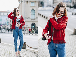 Andreea Birsan - Red Suede Jacket, Graphic Tee, Step Hem Two Tone Mom Jeans, Silver Metallic Block Heel Pumps, Round Mirrored Sunglasses - The best red suede jacket you need in your wardrobe