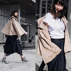 Amber - Chloé Biege Oversize Coat, Lemaire Handkerchief Midi Skirt, Pour La Victoire Lace Up Booties, Red Valentino Knit Ruffle Blouse, Versace Purple Frame Eyeglasses - Quintessential