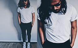 Peter Kennedy - Roger David White T Shirt, Asos Black Trousers, Adidas Sneakers, Ray Ban Sunglasses - Pristine
