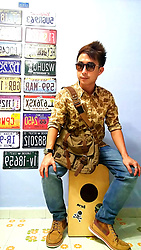Aaron Tan - Brandless Brown Sunnies, Hare Camo Shirt, Mango Man Jeans, Timberland Casual Checkered Boots, Muchuan Vintage Army Messenger, Personal Musical Instrument Cajon - Desert Camo