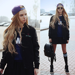 Ekaterina Normalnaya - Long Clothing Mishka 2.0 Death Adder Chain Varsity Jacket, Zaful Black Leather Backpack, Striped Stockings, Sweatshirt, Black Skirt, Mishka Snapback - LONG X MISHKA | epic combination