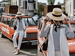 Andreea Birsan - Straw Hat, White Waistcoat, Striped Top, White Suit Trousers, Cream Fur Loafers, Quilted Leather Shoulder Bag - How to style your basics
