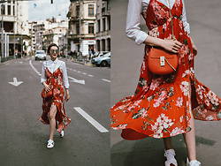 Andreea Birsan - Midi Floral Dress, White Button Down Shirt, Red Crossbody Bag, Ace White Sneakers, Round Mirrored Sunglasses - How to wear a midi floral dress and sneakers