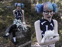 Lindwormmm - Bones Print Bodycon Dress, United Colors Of Benetton Cow Print Skirt, Black Tights, White Socks, Adidas Black Sneakers, Round Glasses, Thrifted Teddy Backpack - Milky Bones