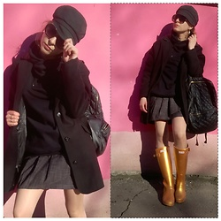Alla Dolzhenko - Accessories Cap, Tally Weijl Oversize Black Coat With Leather, Black Sweater, Gloria Jeans Grey Skirt, H&M Sunglasses, Hunter Gold Rubber Boots, Sinsay Backpack - How pink is this pink wall?