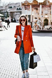 Andreea Birsan - Red Cat Eye Sunglasses, Orange Blazer, Pearl Step Hem Mom Jeans, Gaphic Tee, Superstar White Sneakers, Quilted Leather Crossbody Bag - The orange blazer