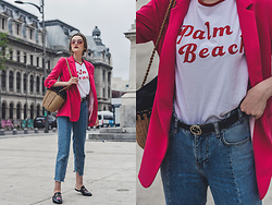 Andreea Birsan - Graphic Tee, Pink Blazer, Woven Bag, Deconstructed Mom Jeans, Belt, Floral Embroidered Mules, Pink Tinted Glasses - The pink blazer crush