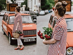 Andreea Birsan - Striped Shirt Dress, Straw Bag, White Pants, Orange Suede Pumps, Earrings - Dress over pants