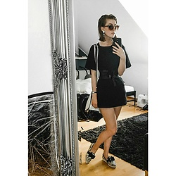 Lary Rauh - Henri Bendel Cognac Sunglasses, Goldknopf Crystal Statement Earrings, Black And White Bag, Cos Black Leather Obi Belt, Cos Black Cotton Mini Dress, Skagen Small Black Wrist Watch, Jeffrey Campbell Shoes Snake Print Bow Loafers - Cinema look