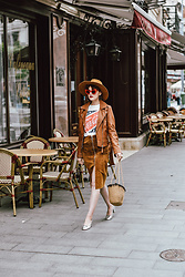 Andreea Birsan - Brown Leather Jacket, Suede Midi Zip Front Skirt, Silver Metallic Pumps, Woven Bag, Coke Tee, Brown Hat, Red Cat Eye Sunglasses - Parisian in Bucharest