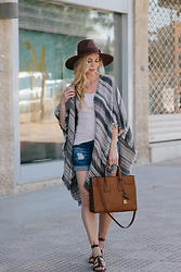 Meagan Brandon - Brixton Panama Hat, Striped Poncho, Loft Tank Top, Ag Jeans Denim Shorts, Similar Sandals - How to Wear a Poncho in Summer