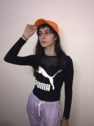 Ellie Nik - Karla Špetić Lilac Pants, Dresslink Orange Dad Cap, Puma Bodysuit - L'Orange