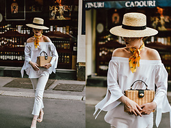 Andreea Birsan - Straw Hat, Off Shoulder Top, White Jeans, Square Straw Bag, Clear Lens Glasses, Yellow Scarf, Floral Embroidered Sandals - The Parisian white summer outfit you will want to reproduce
