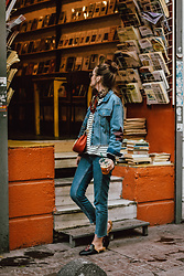 Andreea Birsan - Denim Jacket, Striped Top, Step Hem Two Tone Mom Jeans, Red Crossbody Bag, Embroidered Fur Mules, Scarf, Sunglasses - Istanbul travel guide