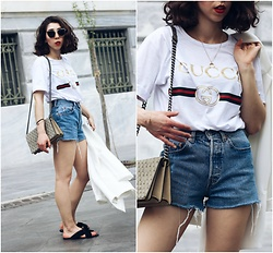 Theoni Argyropoulou - Logo T Shirt, H&M Necklace, Levi's® Denim Shorts, Bracelet, Bershka Blazer, H&M Shoulder Bag, Mango Strap Sandals - Gucci Logo T-shirt on somethingvogue.com