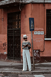 Andreea Birsan - White Wide Leg Pants, Beige Suede Heels, Gingham Off Shoulder Top, White Straw Hat, Skinny Scarf, Black Leather Bag - Cubanita