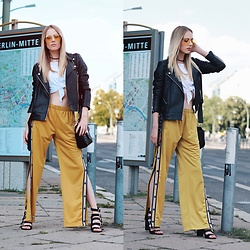 Laura Simon - Fila Yellow Pants, Buffalo Black Sandals, Urban Outfitters White Crop Shirt, Asos Black Leather, Urban Outfitters Yellow Glasses - Berlin Streetstyle
