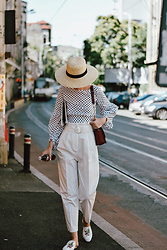 Andreea Birsan - Polka Dot Puffy Sleeves Blouse, Straw Boater Hat, High Waisted White Trousers, Ruby Red Metropolis Bag, White Embroidered Mules - Fill the dots