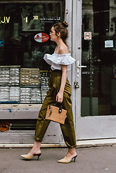 Andreea Birsan - White One Shoulder Top, High Waisted Khaki Trousers, Bamboo Basket Bag, Beige Suede Heeled Mules, Silver Hoop Earrings, Aviator Clear Lens Glasses - The one shoulder top
