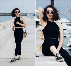 Theoni Argyropoulou - Pull & Bear Crop Top, Zara High Waisted Trousers, H&M Shoulder Bag, Vans Sneakers, Sunglasses, Earrings - Total Black look & white pearls on somethingvogue.com