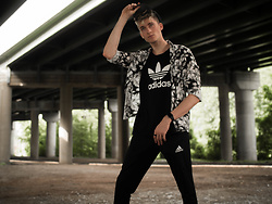 Kieran Brug - Adidas Black Tank Top, Adidas Black Soccer Sweats, Zara Black And White Floral Button Up, Adidas Black Hat, Guess Black Ring - Urban Decay