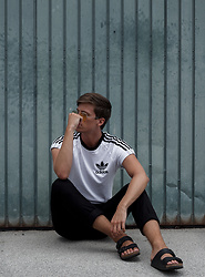 Georg Mallner - Adidas Tshirt, H&M Pants, Birkenstock Shoes, Urban Outfitters Sunglasses - August 10, 2017