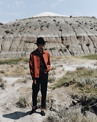 Nigel Lew - Alexander Mcqueen Coat, Measponte Shoes, Comme Des Garçons Hat - The Dig Site