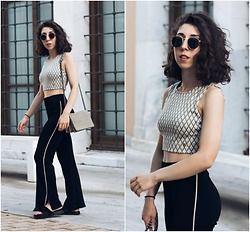 Theoni Argyropoulou - Pull & Bear Sunglasses, Crop Top, Zara Wide Leg Trousers, H&M Shoulder Bag, Slides - Summer City Look on somethingvogue.com