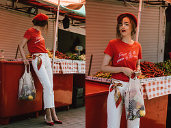 Andreea Birsan - Red Feminist T Shirt, Red Beret, Red Velvet Slingback Shoes, Net Bag, White Mom Jeans, Scarf, Statement Earrings, Clear Lens Aviator Glasses - The trending feminist t-shirt
