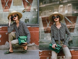 Andreea Birsan - Floral Tie Neck Blouse, Green Suede Shoulder Bag, Khaki Cropped Trousers, Green Snake Print Mules, Embellished 90s Square Sunglasses, Straw Boater Hat - The trend we all forgot about