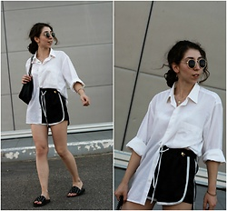 Theoni Argyropoulou - Pull & Bear Sunglasses, Asos Earrings, Slides With Studs, Oversized Shirt, Satin Runner Shorts, Zara Shoulder Bag - Back-to-School Look on somethingvogue.com