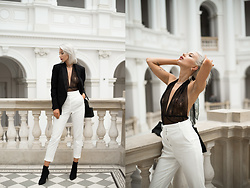 MONIKA S - Tuxedo Jacket, Silver Hoop Earrings, Lace Body, High Waisted Tuxedo Pants, Leather Mini Clutch With Chain, Silver Necklace, High Heel Sock – Style Ankle Boots, Silver Watch - I'VE SEEN THAT FACE BEFORE