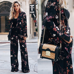 Maria De La Cruz - Haute & Rebellious Basket Bag, Haute & Rebellious Dahlia Floral Print Blazer, Haute & Rebellious Floral Palazzo Pant, Hautea & Rebellious Tassel Earrings - TRANSITIONING SEASONS WITH DARK FLORALS