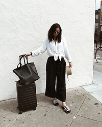 Tiffany Wang - Céline Tote, Zara Pants, Away Luggage, Free People Shirt, Adidas Slides, Lack Of Color Hat - AIRPLANE READY